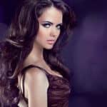 Wavy Hair. Beautiful Elegant Brunette Woman. Healthy Long Brown Hair. Beauty Model Girl.