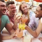 Group Of Friends Enjoying Drinks In Outdoor Restaurant