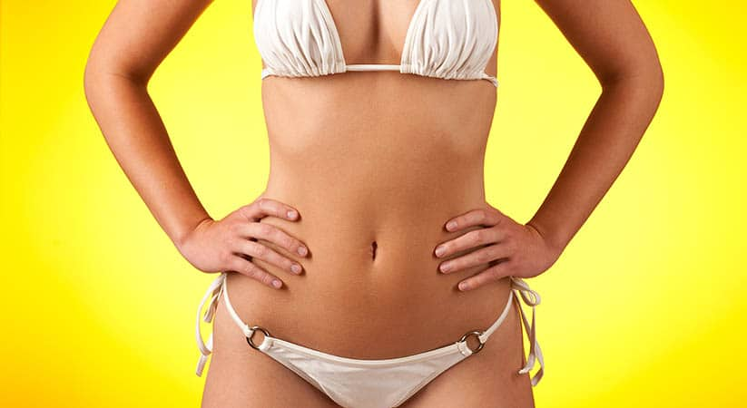 Slim female body with white bikini on yellow background